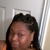 Astou inside The New Afrogenix Braiding Salon