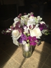 A gorgeous bridal arrangement in purples and whites