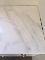 """Staining on """"premium quartzite"""" purchased from DJ Granite and Marble"""