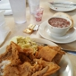 Mother's Restaurant - New Orleans, LA. 1/2 fried chicken w potato salad & red beans/rice.  30 min wait time but well worth it.