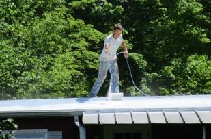 Ivan applying the Conklin Roof Coating