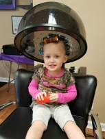 Carley is 2 years old  and enjoys Luxury Salon's Hair styling