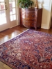 Antique Persian Heriz offers a warm welcome to this foyer...  traditional geometric design along with classic oriental rug colors.