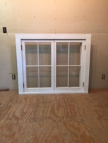 Traditional custom wood double casement window unit, restoration wavy glass, true divided lights, putty glazed, project in Long Island, NY.