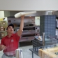 Papa John's Pizza - Anchorage, AK. Employee asked if wanted to watch him throw some dough. Thought it was pretty neat.