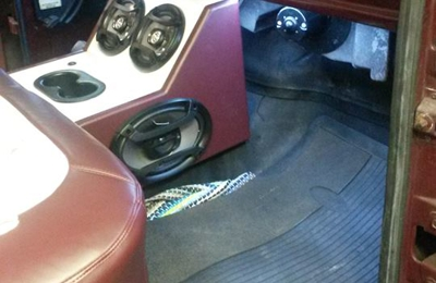 Redline Audio & Performance - Spindale, NC. Custom Console w/ Stereo & 4 Speakers Wrapped To Match Seats