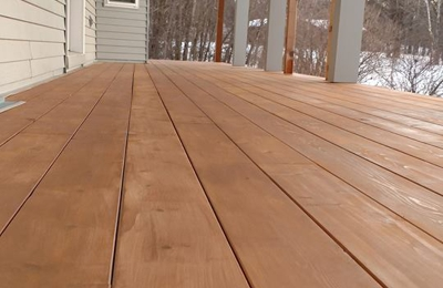 Quality Built LLC - Perham, MN. Gorgeous porch featuring hidden fastener system and cedar planks