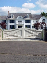 Traditional farmhouse-style residential driveway gate by Tri State Gate, Bedford Hills, New York