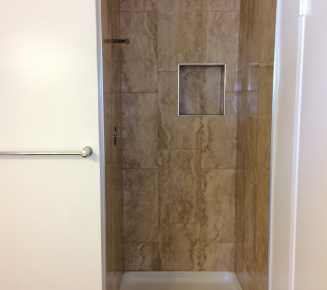 A Dan The Handyman - Santa Ana, CA. After bathroom remodel with new valve, new shower pan, new porcelain walls. Door to be installed soon.