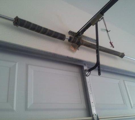 Clarks Garage Door Repair - Los Angeles, CA. He fixed my springs (shown here in photo)