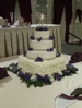 A luxurious  wedding cake decorated with fresh flowers from Taylor's