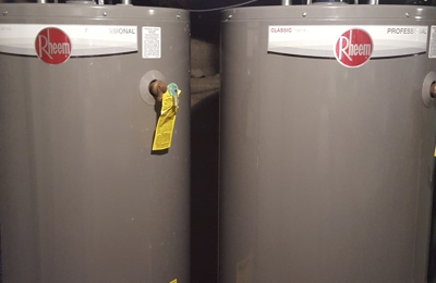 Lock & Sons Plumbing & Heating - Sterling, CO. Two new 50 gallon RHEEM water heaters with related copper piping. A  JOB WELL DONE !