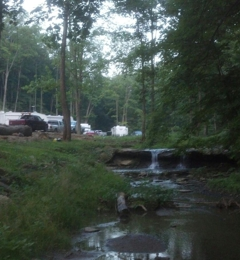 Creekside Camping L.L.C. - Triadelphia, WV. Creekside camping waterfall.  Enjoy a relaxing evening listening to the water, sitting by the campfire in the hills of West Virginia.  Enjoy