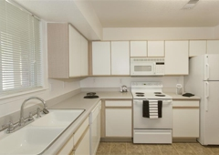 Village at Bear Creek Apartment Homes - Denver, CO. Kitchen