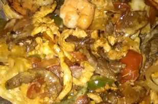 Shrimp, Chicken and Steak NachoComes with Salsa and ChipsGotta try it!!!!!