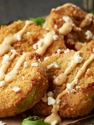Hand-breaded and topped with feta cheese and red chili ranch.
