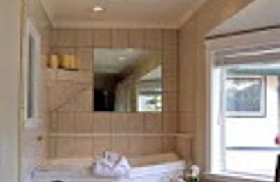 A Beachside Luxury Inn - Juneau, AK. Penthouse 2 person spa tub overlooking the mountains and water