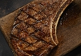 LongHorn Steakhouse. Well-marbled and tender, bone-in cut, grilled over an open flame for a rich, juicy flavor.