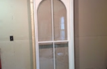 Inner arched top traditional double hung window unit with weights and pulleys, restoration project in NY.