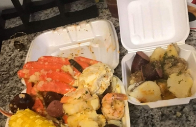 Wats Crackin Garlic Crabs - Atlanta, GA. This is a more realistic picture of what you get from wats crackin They must keep them show boxes for themselves because this right here is what their customers are going to get! They are very unapologetic. I should have not passed go on this one! Their handwritten sign says check your box before you leave but try doing that with a nasty greasy bag that's locked right in two buttered up knots!