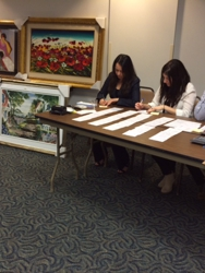 Volunteers at Marlin Art fundraising art auction recording bids!